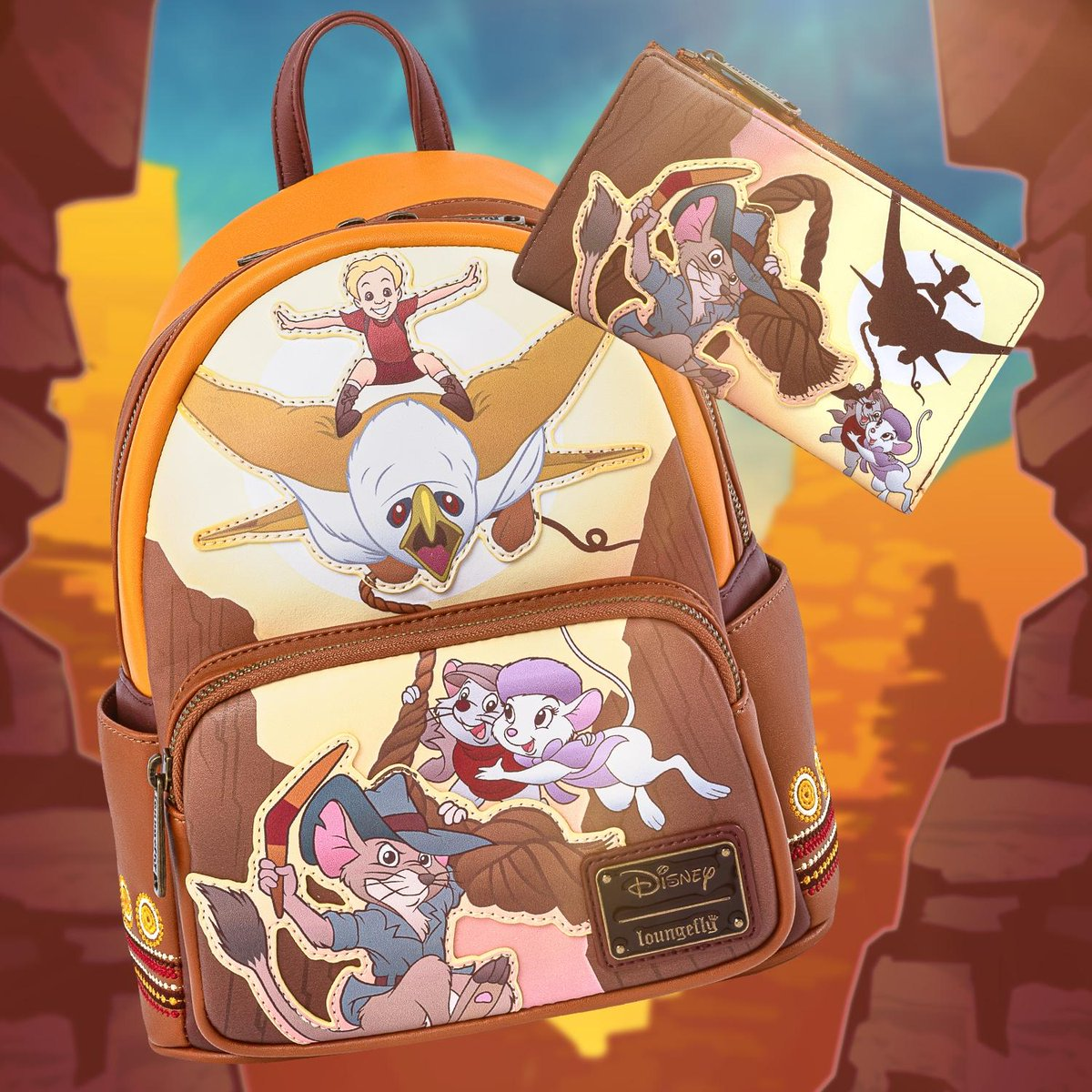 The Rescuers Down Under collection is now available!!! Grab the beautifully embroidered mini backpack and wallet for your many adventures on bit.ly/2T8WXru! 🧡🤎💛#Loungefly #Disney