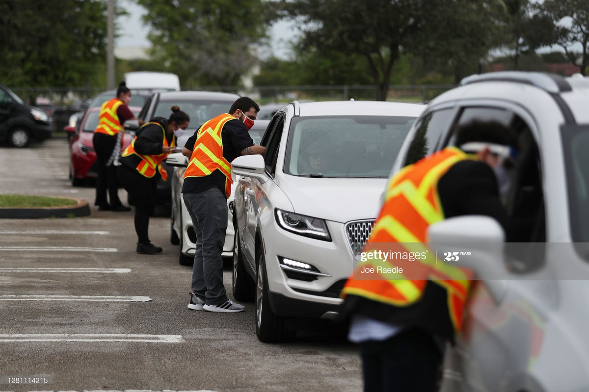 Poll workers receive Vote-by-Mail ballots in a drive-thru system setup at the Election Headquarters polling station in Doral, #Florida 📸:   @jraedle #2020Election https://t.co/d21gma8Iuz
