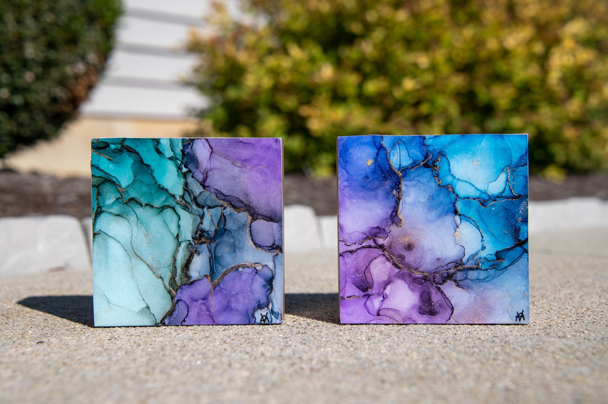 beautiful pieces of blue, purple, and gold alcohol ink paintings on wood