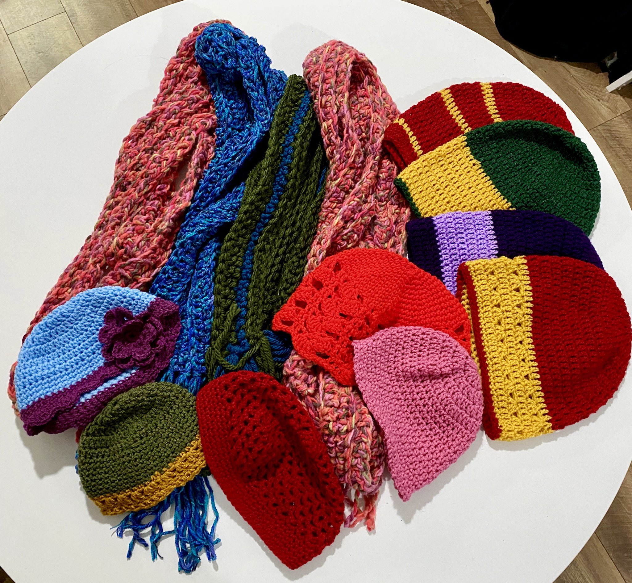 A variety of colourful hats and scarves.