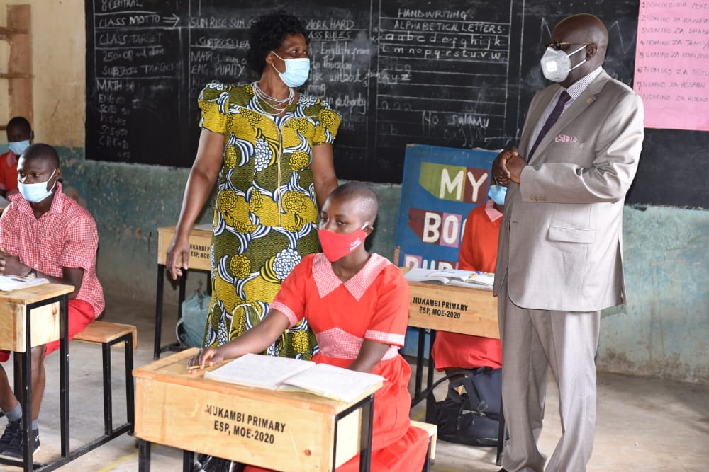 Education CS Prof. George Magoha at Mukambi Primary School in Kakamega County on Friday to assess supply of desks under the locally Assembled desk for schools stimulus project.