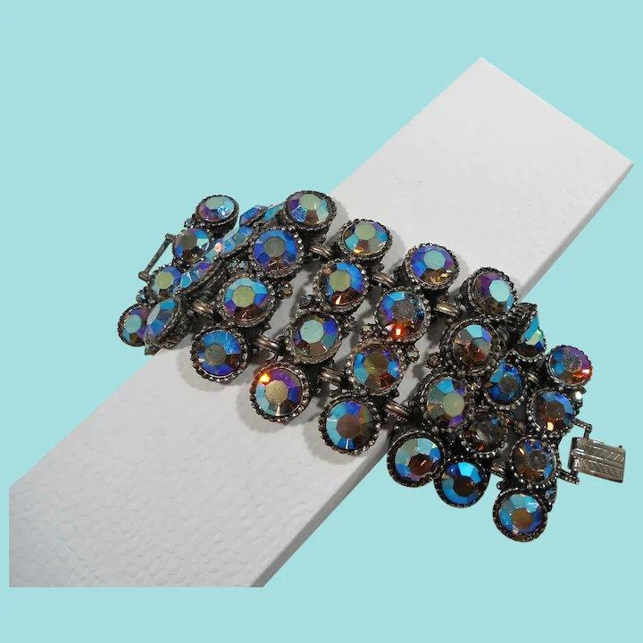 Massive Wide Chunky Blue Aurora Rhinestone Bracelet #rubylane #vintage #retro #bracelet #giftideas #fashionista #diva #glam #rhinestones https://t.co/28W2AmSoxt https://t.co/TUM1nlbYhr