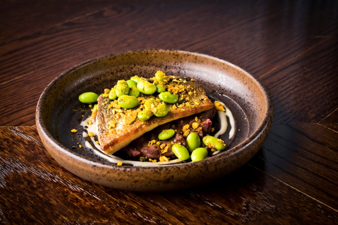 Our beautiful pan-fried sea bass dish is served with fava beans, dukkah, tahini and lemon. Available this evening in the Dining Room. Click here to book in for an evening of Voltini small plates & drinks: bit.ly/2GBQ9Qa