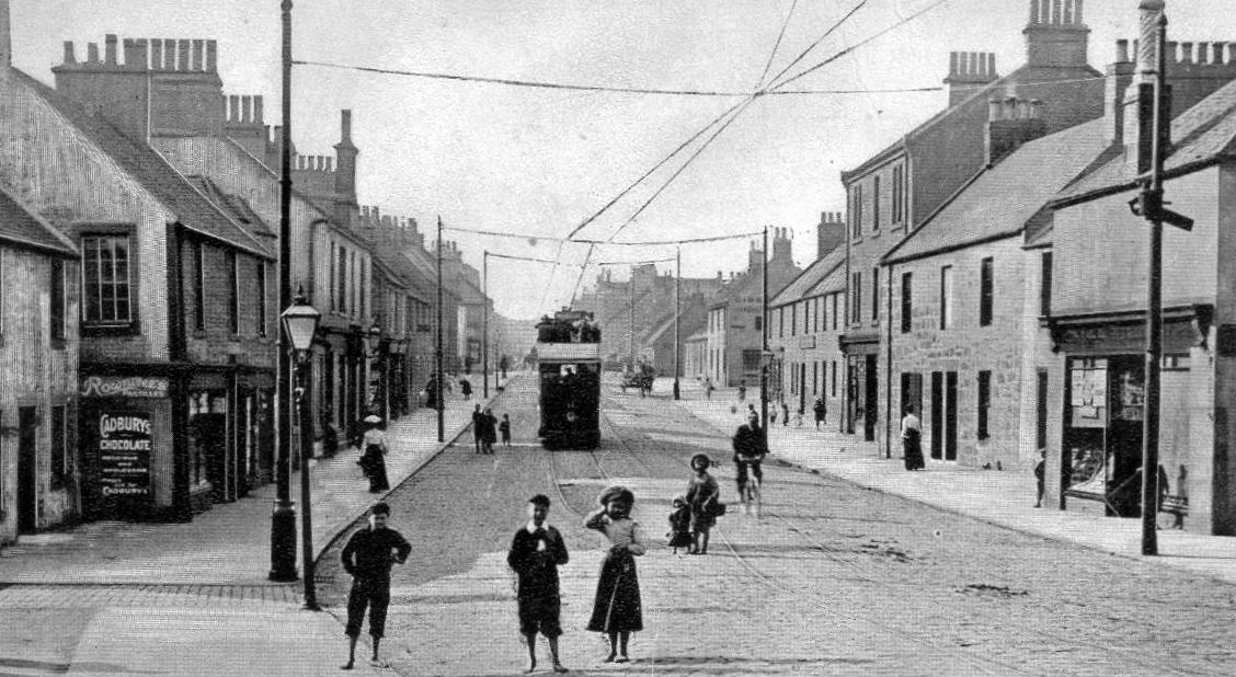 Old Tour #Scotland Ancestry Travel visit Genealogy Scottish Family History Blog photograph of a Tram, shops and people and information and story of #Bainsford located North of #Falkirk, It is between the #River #Carron and the #Forth and #Clyde #Canal https://t.co/axmKsRRVjB https://t.co/3mVUDUzm0G