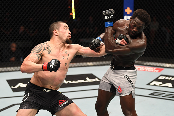 #UFC254 Official Result: @RobWhittakerMMA (29-28, 29-28, 29-28) def Jared Cannonier by Unanimous Decision  All Results: https://t.co/3x8Pov4w4Y  #InAbuDhabi | @VisitAbuDhabi https://t.co/nCTLZG20q3