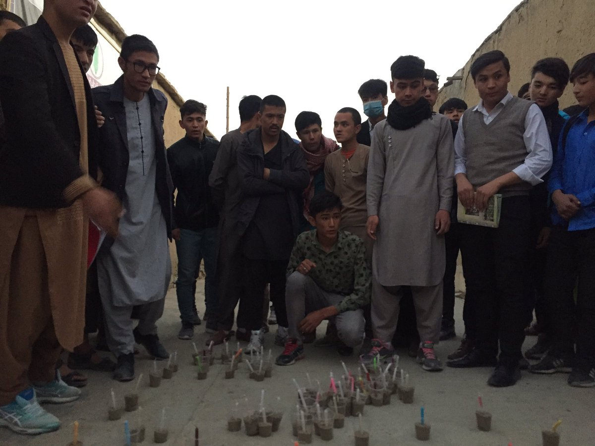 """Vigil at the tuition centre in Kabul attacked yesterday by a Daesh suicide bomber, killing at least 24 people... the students are writing """"memorial of the martyrs"""" in chalk and candles"""