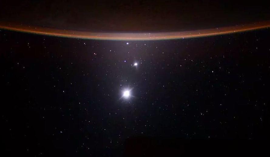 Replying to @marsrader: Earth-Moon-Venus-Jupiter alignment from the International Space Station.