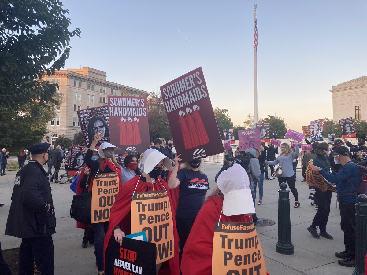 """People with @yaf are trolling the anti-ACB handmaids at the Supreme Court by holding up signs that read """"Schumer's handmaids"""": https://t.co/MNijmzqOhe"""