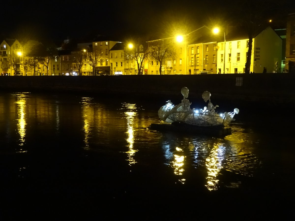 """#CorkIrlmemory """"Two in a boat on the Lee"""" - wonderful creative work by @corkartlink; the Dragon of Shandon may not stalk the streets of Cork this year but certainly lives this year in people's grateful hearts, and underlings on the River Lee :) @pure_cork @CorkHealthyCity #corkcc https://t.co/oh58Mbw8cB"""