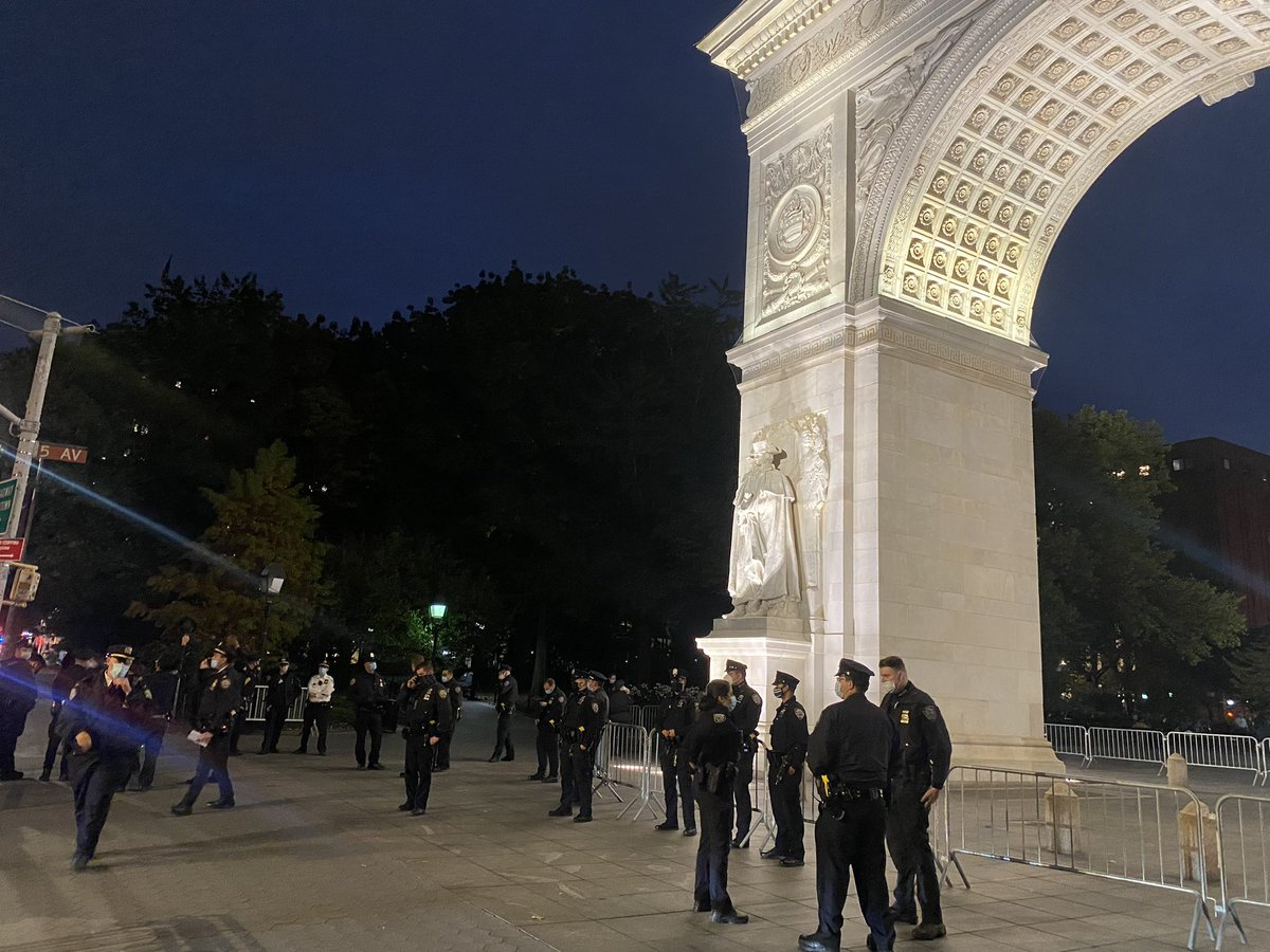 """There are about 60 cops guarding the arch at Washington Sq Park. One said they're here every day, """"since people started vandalizing it."""" Since when? """"Can't remember."""" Seems like a lot of cops for that. """"There's a lot of people in the park."""""""