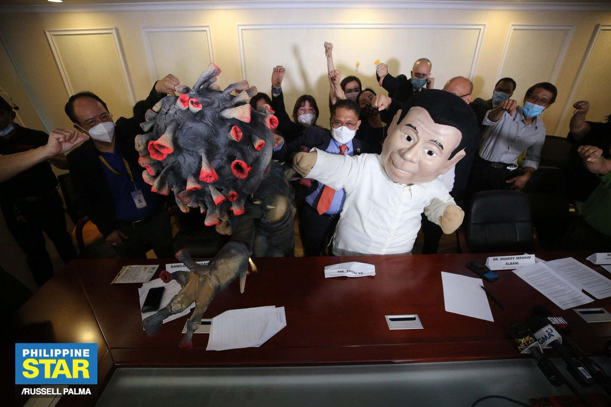 A mascot of President Rodrigo Duterte punches another mascot representing the new coronavirus during a press conference of a joint movement pushing for free COVID-19 vaccination on Wednesday. https://t.co/Iu197K0UkK