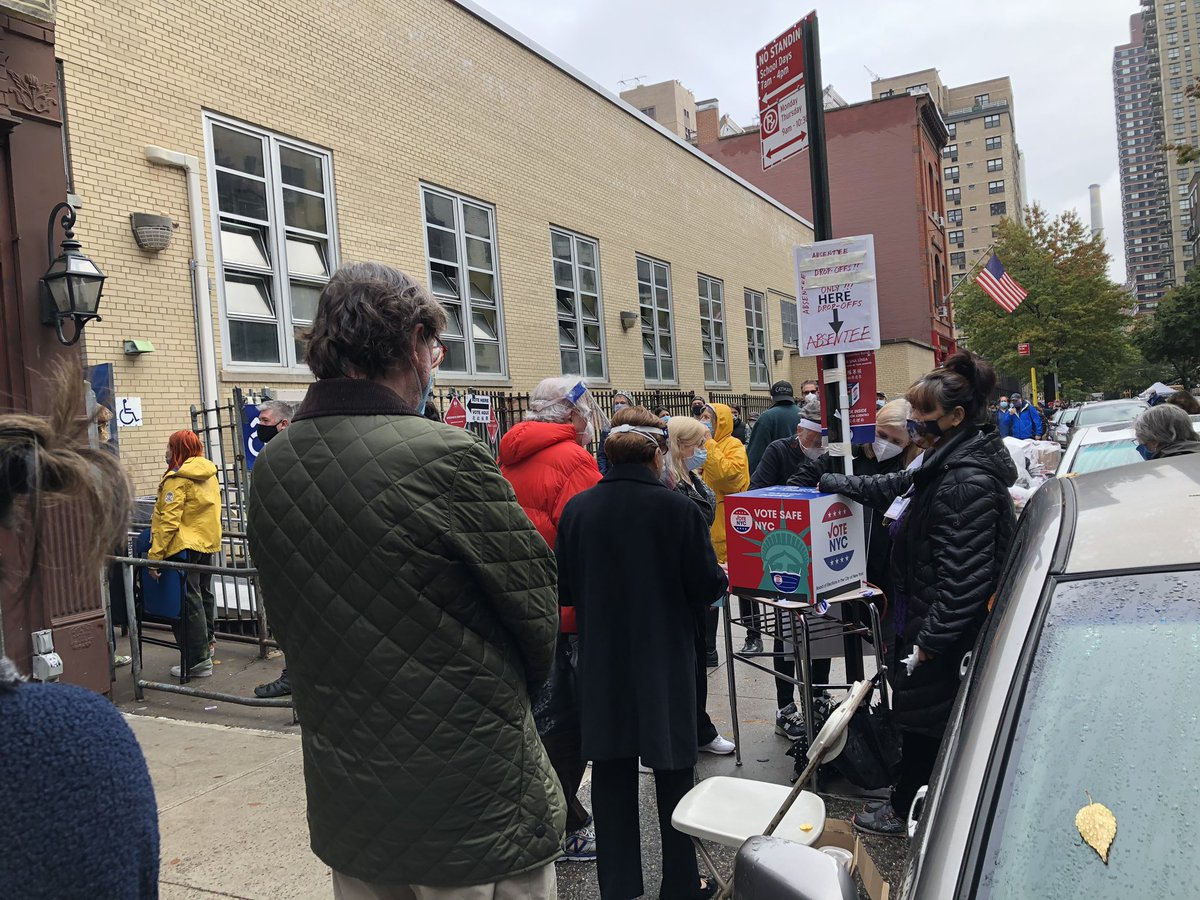 There's an improvised ballot box outside the school, a poll worker says they devised this yesterday realizing having yet another line of people entering the building was too much.