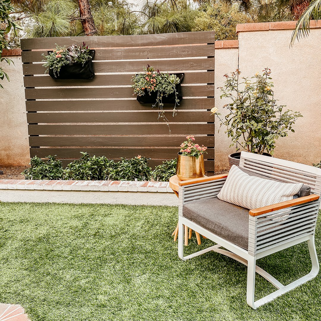 """Formerly a place for playdates, @AnitaYokota's backyard is all grown-up 🙌 and now features a sanctuary-inspired """"living"""" fence painted in our 2021 #SWColoroftheYear, Urbane Bronze SW 7048. Get the project details: https://t.co/ywqmbSlfTA #sherwinwilliams #patio #diy https://t.co/J483ZPrLjI"""