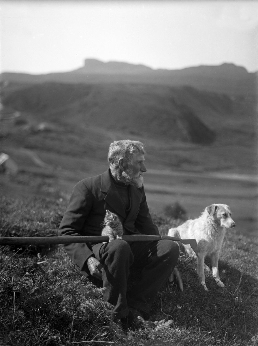test Twitter Media - A6 Scotland has too many sides to possibly capture in a single photo. Still, here's Lauchlan MacAskill with his peat spade, pet dog, and kitten on the Isle of Eigg (where a 166 million-year-old dinosaur bone was just found), 1920s 📸 by Mary Ethel Muir Donaldson #ScotlandHour https://t.co/IbHeTZBLWU