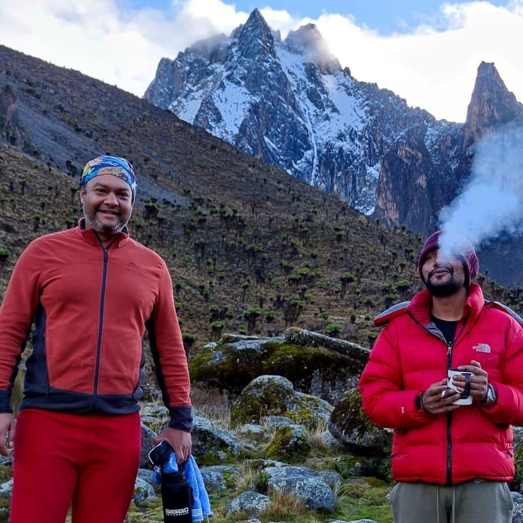 #MountKenyaExperience: Coffee with early morning views of the majestic peaks of Mt Kenya. From the left (Batian, Nelion, point John)  Credit: Bhavesh Sumaria  #mountainviews #mtkenya #hikingadventures #mountainclimbing #mountaineer #climbing #mountainhiking #mountainclimbing https://t.co/9HN3HcAIVp