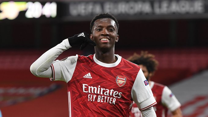 Eddie Nketiah celebrates by posing for the camera with his hand held to his head to imitate answering a phone call