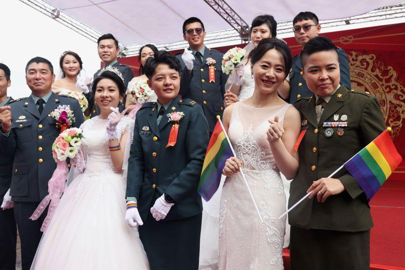 'Coming out bravely'- Taiwan same-sex couples join military wedding for first time https://t.co/s8eo0LaBB9 https://t.co/queF3kMt8k