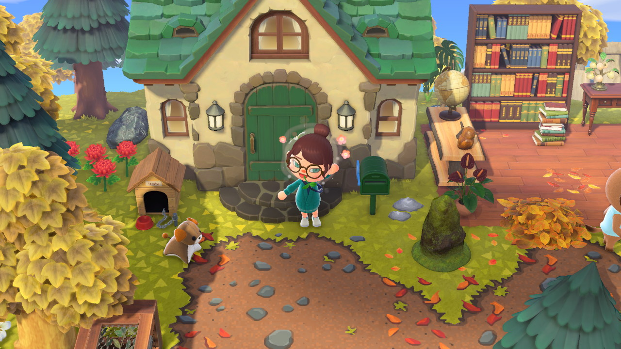 On voit un avatar Animal Crossing devant une maison.
