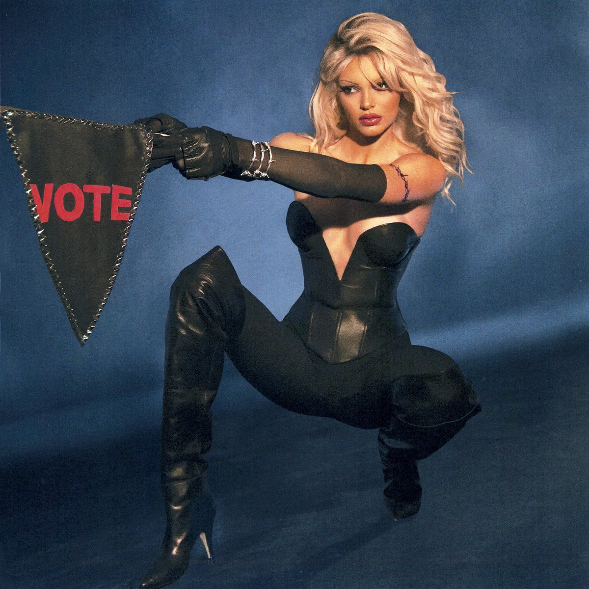 me as Pamela Anderson in Barb Wire ... GO VOTE!!!