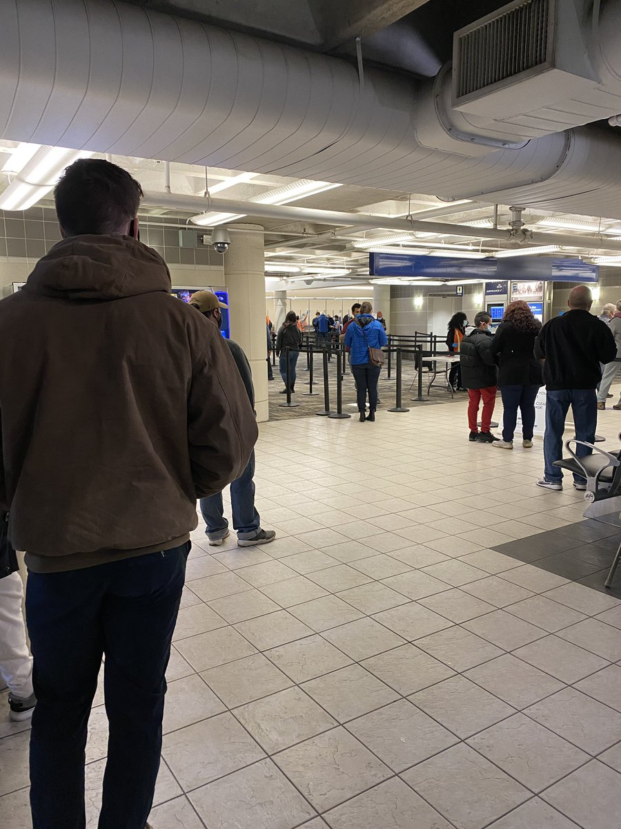 Covid testing site at MSP airport. The line is going to take probably 30 minutes. I'm five days out from being exposed to it. I really thought the apocalypse would be more exciting. #COVID19