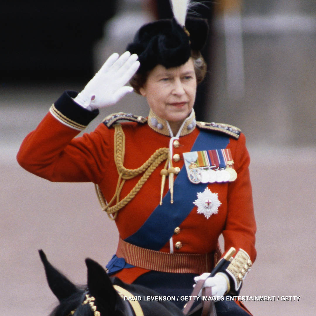 Duty calls. Queen Elizabeth II takes the salute at the Trooping the Colour ceremony outside Buckingham Palace.
