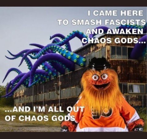 "Orange hellbeast in front of a building with tentacles with text ""I came here to smash fascists and awaken chaos gods... and I'm all out of chaos gods"""