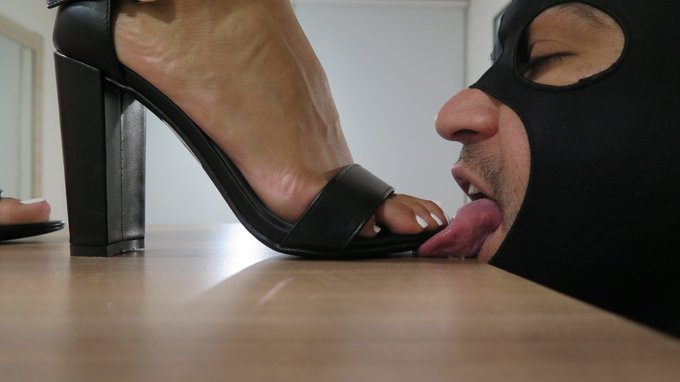 2 pic. Yes... he is my boyfriend. And I'm in charge here !  #footdom #footfetish #highheels #mistressenola