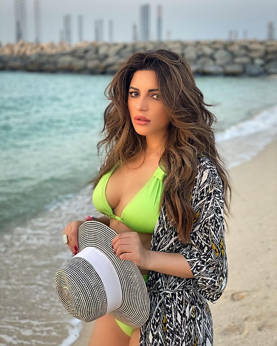 Shama Sikander Flaunts her Figure in Neon Green Bikini -newsdezire
