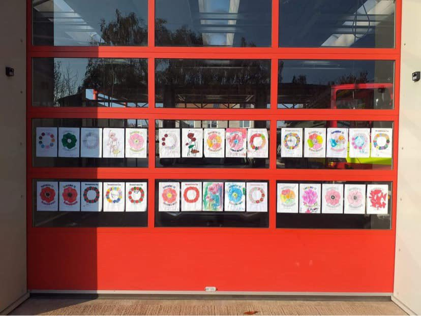 Poppy drawings and colourings have been put in the bay doors at Carlton Fire Station 👏 #ArmisticeDay