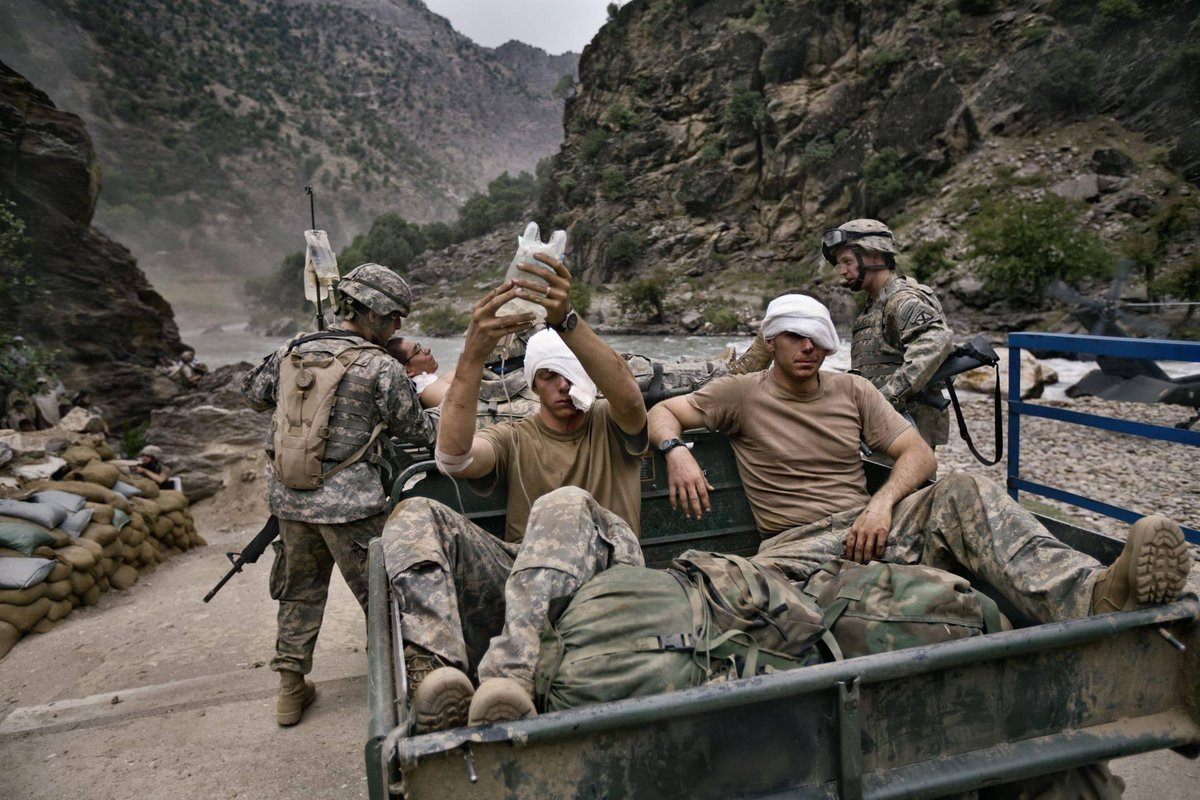 Thinking of those who serve and sacrifice on this Veterans Day.   Below: PFC Johnny Araujo, SPC Clinton Howe, SGT Jeremy Larson of 3-71 CAV, in Kamdesh, Afghanistan, 2006  Thank you, gentlemen  Photo by Getty Images