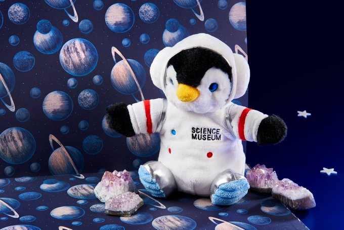 A penguin soft toy in a space suit with the words Science Museum embroidered on