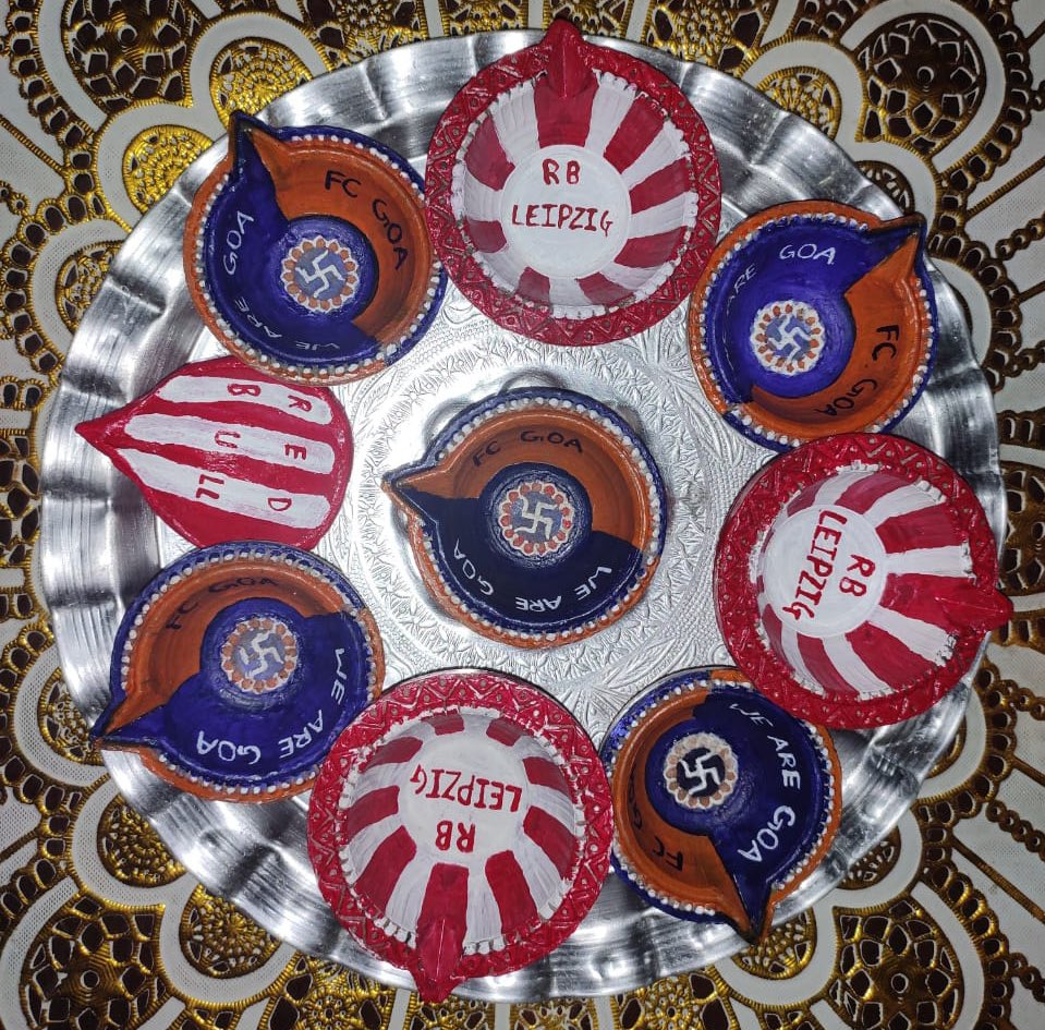 To celebrate the Strategic Cooperation between @fcgoaofficial and @RBLeipzig_EN Pooja and her 10year old son Ved Hand Painted these Diya's for Diwali 🪔   #WeAreGoa #ForcaGoa #FCGoa #RBLeipzig #DreamsStartHere