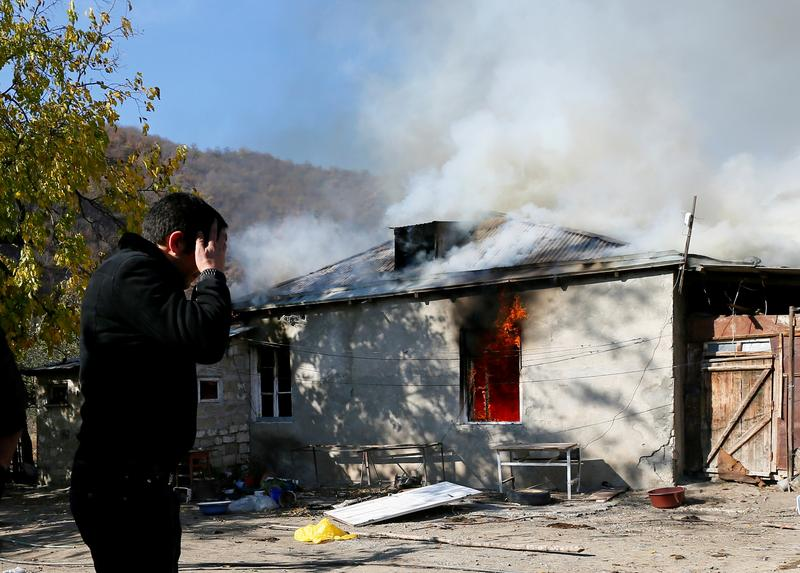 Armenians set fire to homes before handing village over to Azerbaijan reut.rs/32KJ8o4