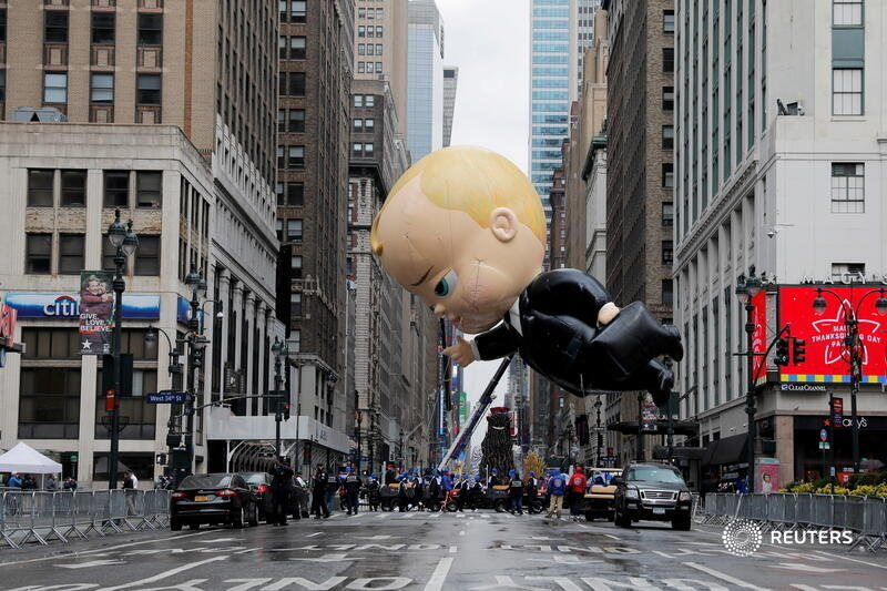 Assistants carry 'The Boss Baby' balloon during the 94th Macy's Thanksgiving Day Parade, which was closed to spectators due to Manhattan's coronavirus spread. More photos of the day: https://t.co/P7fRnk1ZvD 📷 Andrew Kelly https://t.co/8UYUBQa6lz