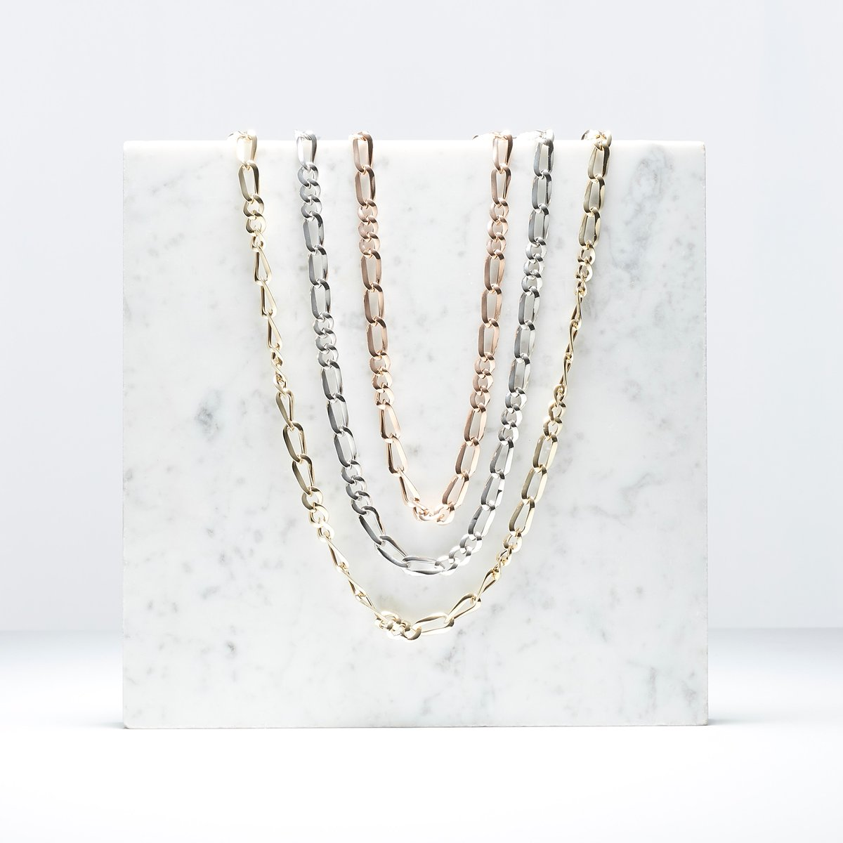 """This """"Tre + Tre"""" necklace features two different sets of three links that alternate throughout the piece. This one is customizable in your choice of yellow, white, or rose 14K gold and four different lengths. ✨"""
