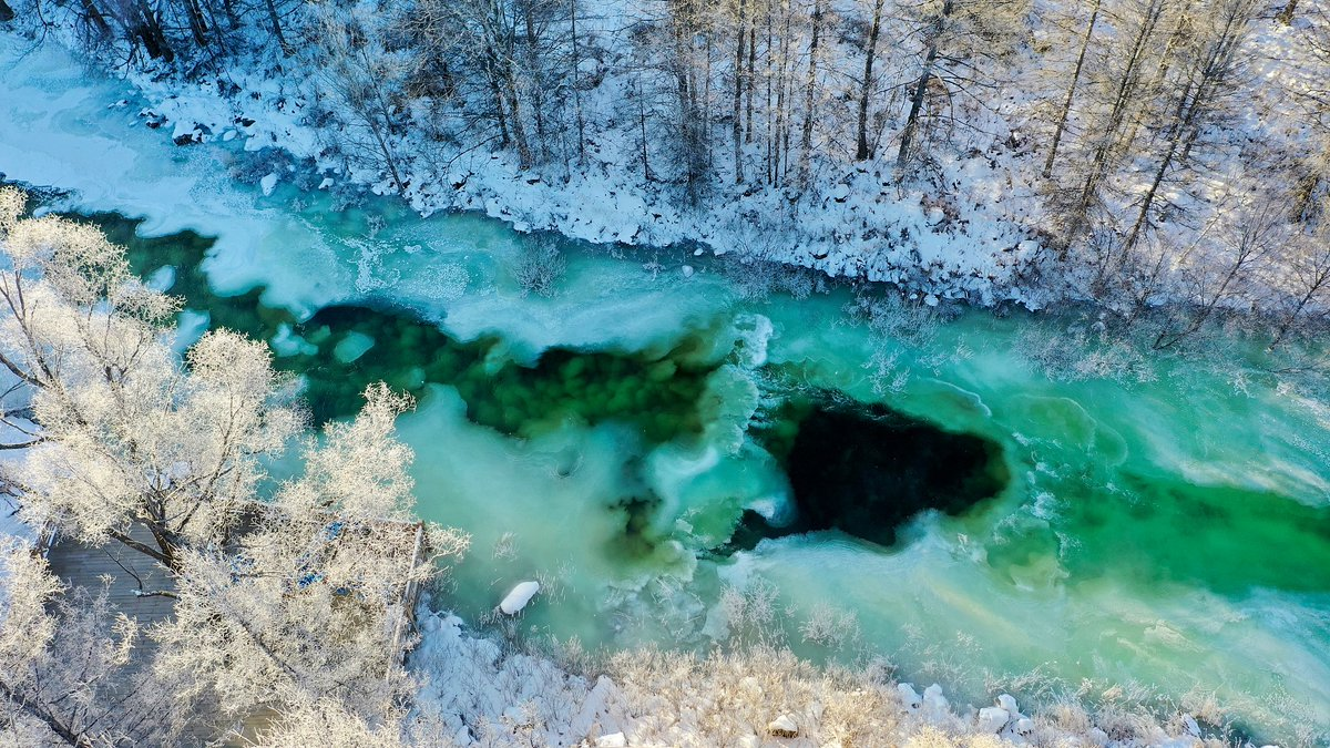 Never-freezing jade lake   Geothermally-affected, a section of a river never freezes despite the temperature drops to as low as minus 40 degrees Celsius in Arxan National Geopark, north #China's Inner Mongolia Autonomous Region.