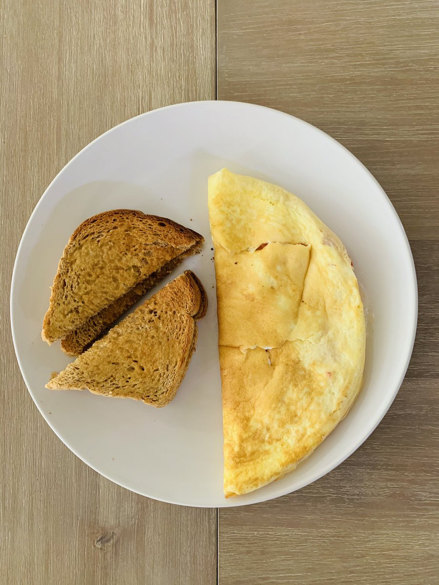 #SaturdayBreakfast #Omelette with tomato 🍅 cheese 🧀 served with toasted-buttered bread 🍞 #yum 😋 Morning saviour 😁#SaturdayMorning #SaturdayKitchen #SaturdayFood #SaturdayExpress #Eggs #vegetables #foodie #homemade