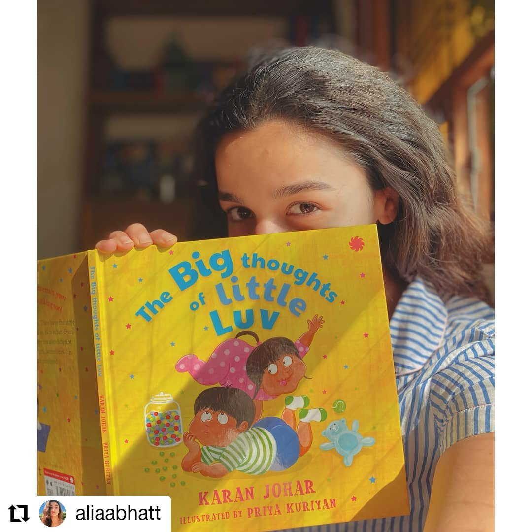 Alia Bhatt catching up on reading before heading to a shoot! How adorable!   Grab your copy of Karan Johar's The Big Thoughts of Little Luv here:    @karanjohar  @aliaa08
