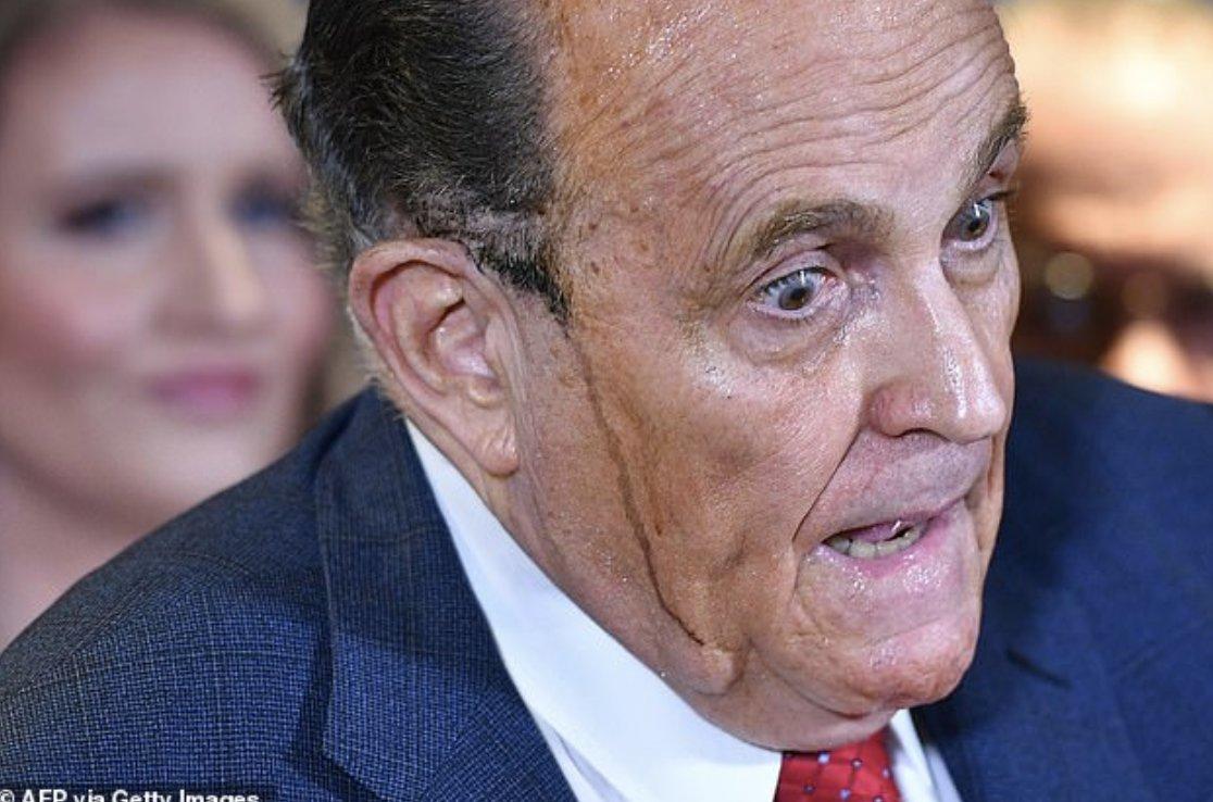 Giuliani perspires as he speaks according to @AFP caption