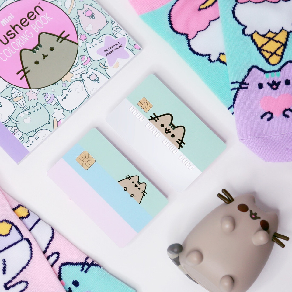 NEW ✨ You can now #Pusheenify your debit, credit, or transit card with @cucucovers! Choose from a variety of 45 adorable #Pusheen designs and just stick it on top of your card. For more info and where to shop, click the link! bit.ly/3jdr24S