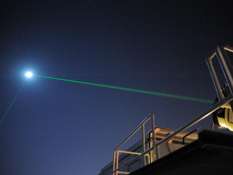 A commercially available laser pointer will hit the Moon, but the beam will be dispersed across a very wide area.
