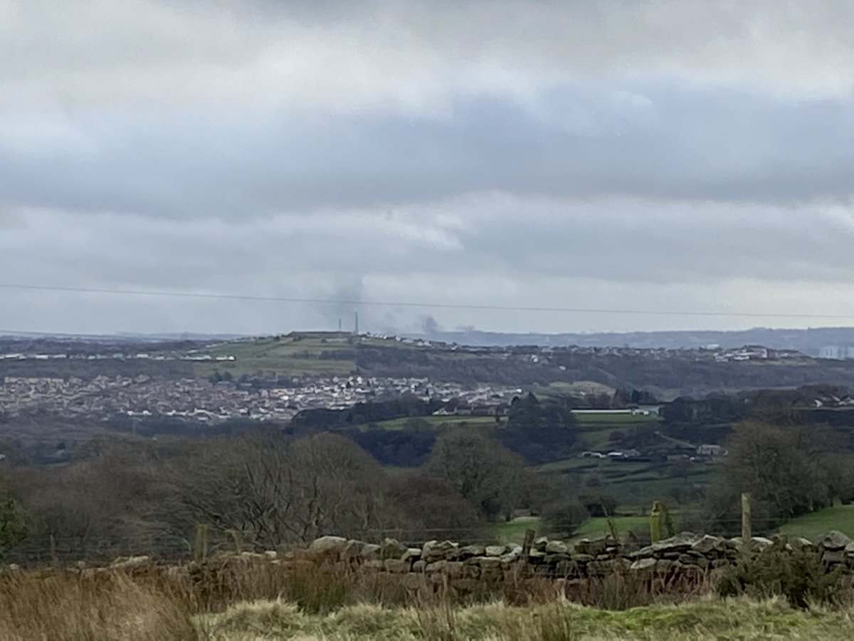 Looking over to #bradford from #hawksworth moor. Looks like the tyre fire is still smouldering.
