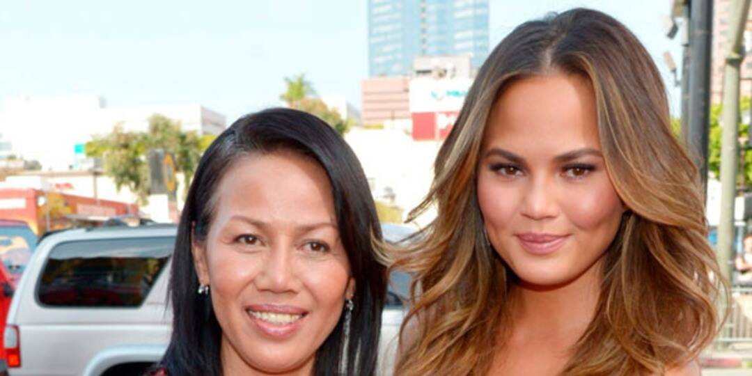 Chrissy Teigen Cuddles With Her Mom After Sharing She Had the Hardest 4 Days of My Life Photo