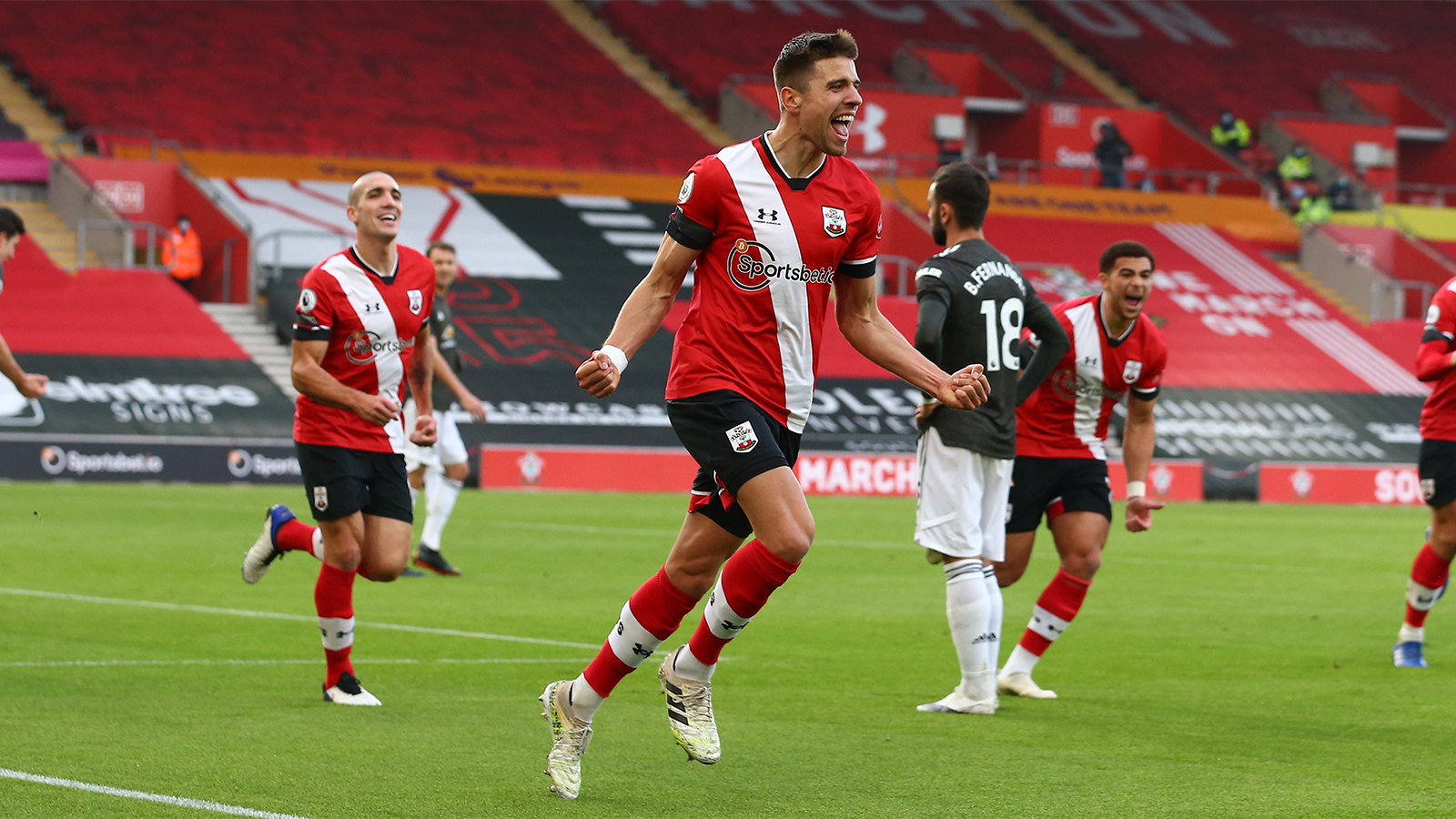 Jan Bednarek runs away celebrating after scoring.