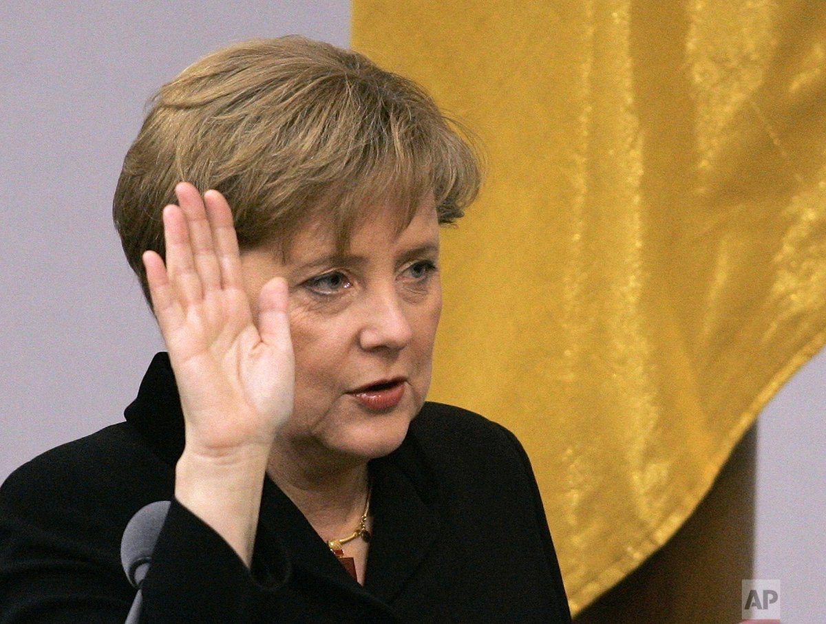 15 years ago today, Angela Merkel took power as Germany's first female chancellor.   Newly appointed German chancellor Angela Merkel takes the oath of office in the parliament in Berlin, Nov. 22, 2005.
