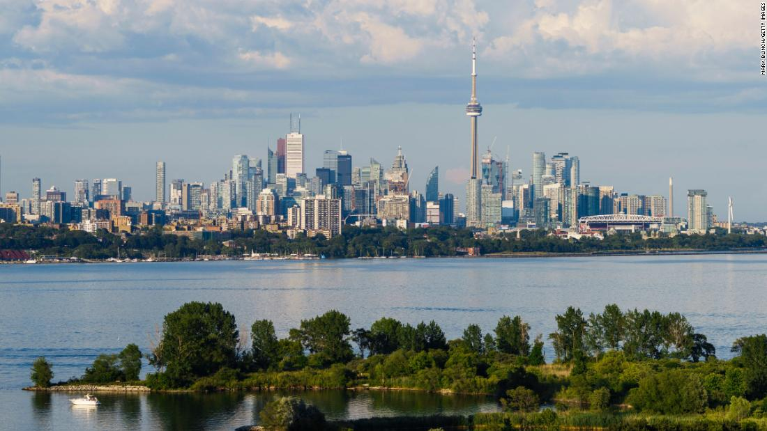 Toronto, Canada's largest city, was placed into lockdown for 28 days on Friday, with officials shutting shops, businesses and restaurants and banning indoor gatherings to curb a growing spike in Covid-19 cases.