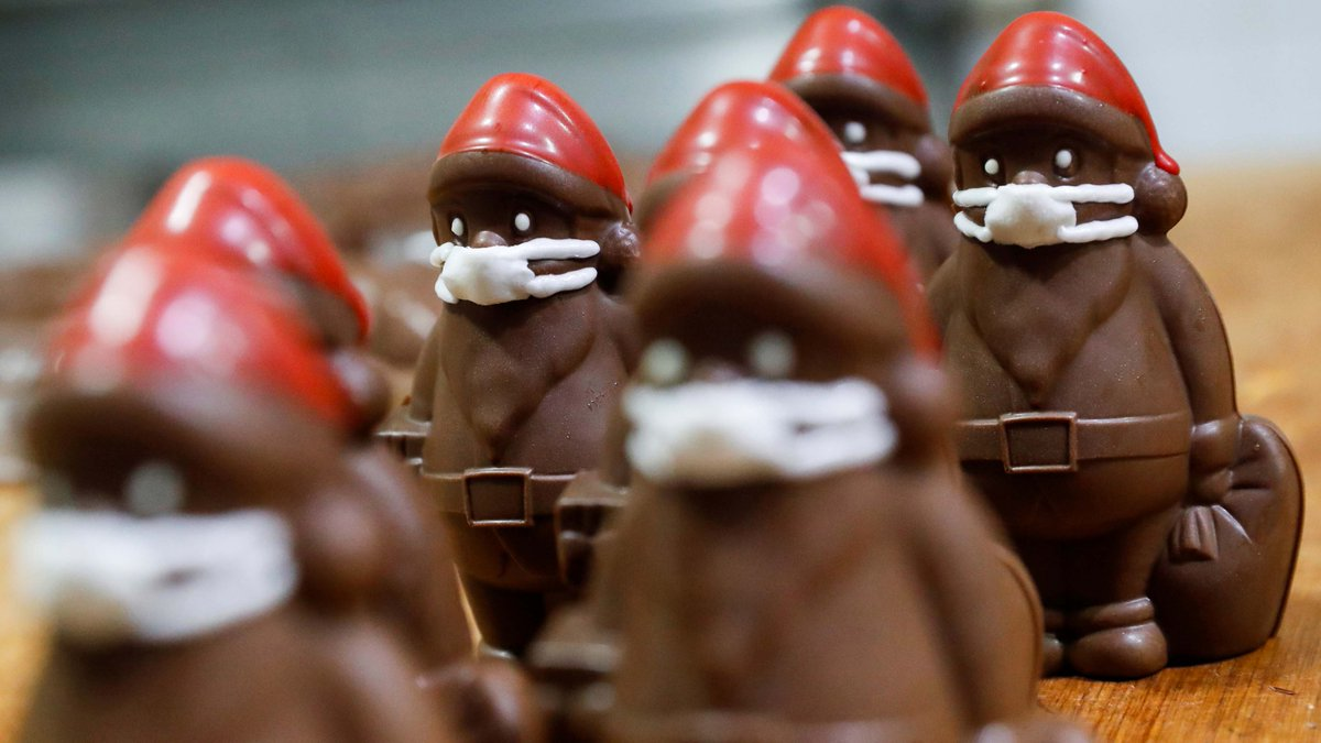 Chocolate Santas wear protective face masks in Laszlo Rimoczi's candy workshop in Hungary amid COVID-19.