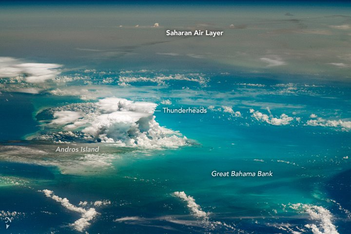 A towering thunder cloud over Andros Island stands at the intersection of moist tropical air and dry, dusty plumes.  #Bahamas