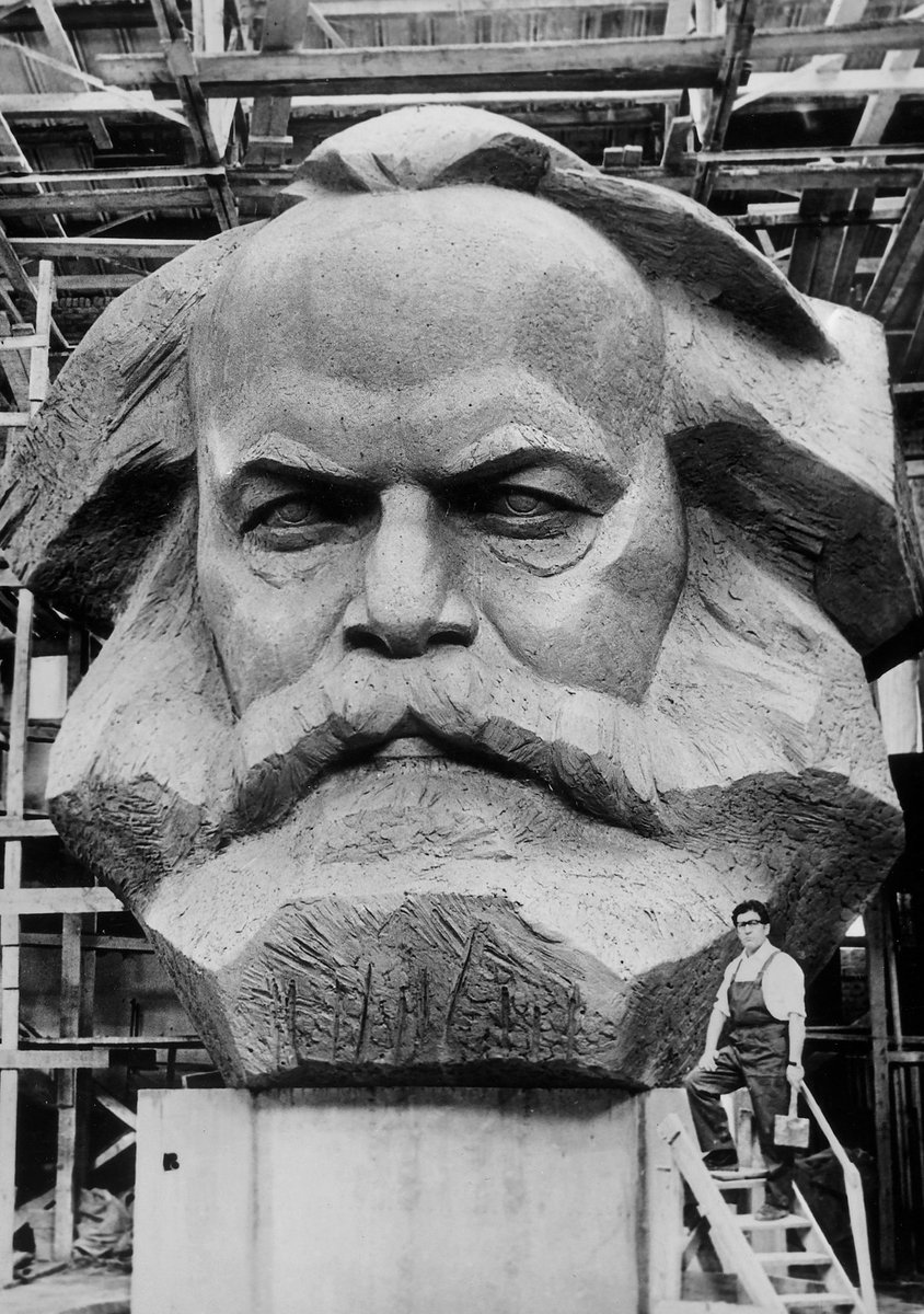 Soviet sculptor Lev Kerbel works on a clay model for a monument to Karl Marx, 1970