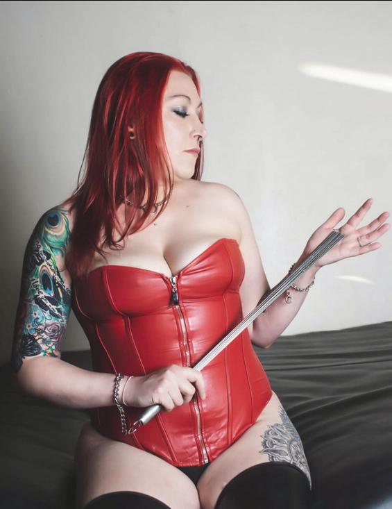@Miss__Bedlam #beauty #Mistress #Mistressmonday #Bdsm #redhead #whips #tattoo #inked #heels #boots #corset #kink